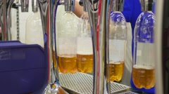 Pouring of beer from kegs into bottles in the store Stock Footage