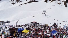Quadrocopter shoot snowboarders, skiers in encamp. Ski resort. Ski lifts. Sunny Stock Footage