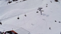 Quadrocopter shoot snowboarders and skiers in encamp. Ski resort. Ski lifts. Sun Stock Footage