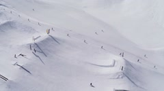 Quadrocopter shoot snowboarders and skiers ride uo on slope. Ski resort. Sunny Stock Footage