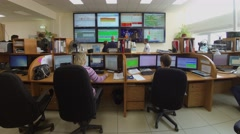 People work near displays in operations room of MGTS company. Stock Footage