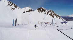Quadrocopter shoot snowboarders riding on springboards on ski resort. Landscape Stock Footage