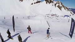 Quadrocopter fly above springboards on ski resort. Landscape. People. Sunny day Stock Footage