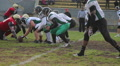 Gridiron players fighting for ball on scrimmage line, offense attack on defense HD Footage