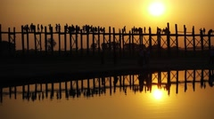 Famous U-Bein teak bridge at sunset, Mandalay Stock Footage