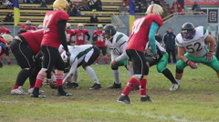 Strained attack on scrimmage line, winners celebrating success, gridiron match Stock Footage
