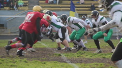 Opposing football teams start massive attack, tackle player with ball, scrimmage Stock Footage