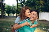 Man carries a girl on his back Stock Photos