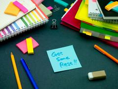 Somebody Left the Message on Your Working Desk; Get Some Rest Stock Photos