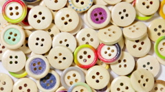 Mixed coloured bright wooden buttons background Stock Footage