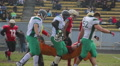 Supportive football players carrying injured teammate on stretcher, togetherness HD Footage