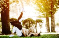 Couple laying on the grass Stock Photos