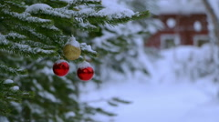 Snowfall and Christmas Balls on the Tree Near the House. Seamless Loop Stock Footage