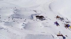 Quadrocopter shoot ski resort. Springboards. Ski lift. Snowy mountains. Riding Stock Footage