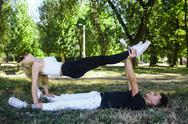 Man and woman performing tricks Stock Photos
