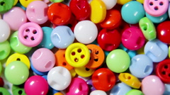 Mixed coloured bright buttons background Stock Footage