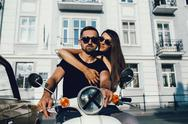 Cute couple with their scooter Stock Photos