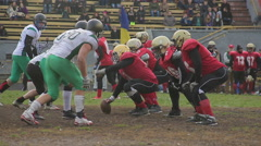 Blazing attack of offence team on defense ball carrier, american football match Arkistovideo