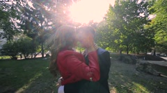 Happy couple having fun outdoor. Young man and woman spinning and laughing Stock Footage
