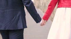 Guy holding the girl's hand and then gradually lets go Stock Footage