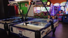 View of gaming machines in entertainment club. Air hockey, basketball, games Stock Footage
