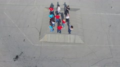 Eleven people team dance on square near space ship Souz monument Stock Footage