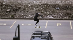 Skateboarders riding on parking space, make flip. Skateboard. Extreme hobby Stock Footage