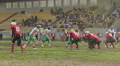 Active player saves ball from crossing team's goal line, American football match HD Footage