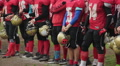 Gridiron football teams and coaches lined up at ceremony to open championship HD Footage