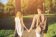 Man and woman walking in the park Stock Photos