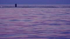 Seaside in the evening, tranquil water surface Stock Footage