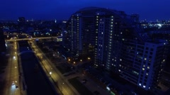 Cityscape with quay traffic near residential complex Arco di Sole Stock Footage