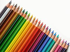 Colored pencils in a row Stock Photos