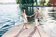 Man and woman posing on the lake Stock Photos