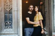 Couple posing in the doorway Stock Photos