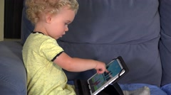 Emotional little girl playing game with tablet computer Stock Footage