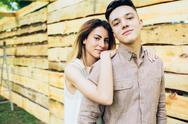 Couple posing on a background of the wooden wall Stock Photos