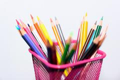 Colored pencils and sharp in penholder Stock Photos