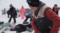 Group of snowboarders warm up before riding on ski resort. Mountains. Exercises Stock Footage