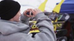 Man shoot on smartphone snowboarder on ski resort. Sport. Encamp. People Stock Footage