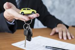 Car key for Vehicle Sales Agreement. Stock Photos