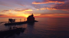Amazing sunrise with Lake Michigan lighthouse, moving aerial perspective Stock Footage