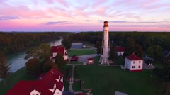 Amazing dawn with Lake Michigan lighthouse, moving aerial perspective Stock Footage