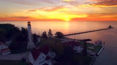 Amazing dawn with two lighthouses on Lake Michigan, moving aerial perspective Stock Footage
