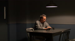 NERVOUS TIME IN AN INTERROGATION ROOM Stock Footage