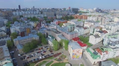 Cityscape with road traffic on Tsvetnoy Boulevard near monument Stock Footage