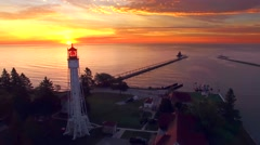 Amazing dawn with two lighthouses on Lake Michigan, moving aerial perspective. Stock Footage