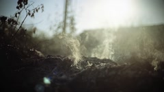 Sun gets through the smoke. On a battlefield. Soot. Grime. Wartime. Stock Footage