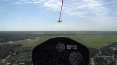 Cockpit point of view POV footage in modern glider sailplane landing on grass 4k Stock Footage