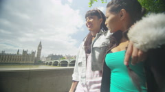 4k Happy friends in London, chatting as they walk through city Stock Footage